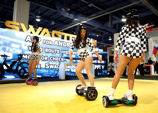 Models perform on Swagtron hoverboards during the 2017 CES in Las Vegas, Nevada January 6, 2017. (Photo by Steve Marcus/Reuters)