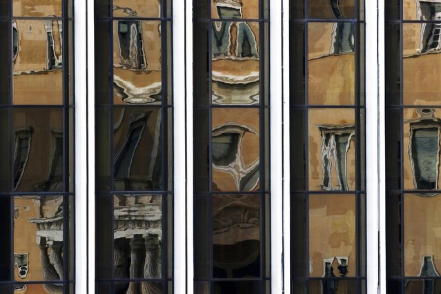 The Greek parliament is reflected on the Foreign Ministry building in Athens March 12, 2015. (Photo by Yannis Behrakis/Reuters)