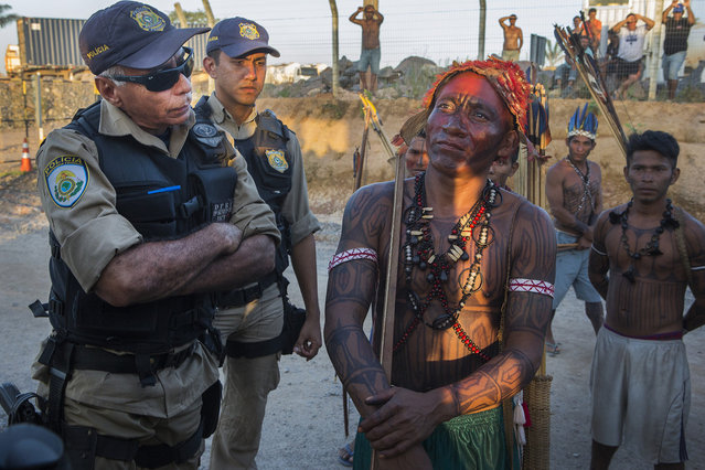 An indigenous Munduruku man and member of the Federal Police argue during an occupation of the Belo Monte Dam. The Belo Monte is the first of a series of dams planned across the Amazon, and the Munduruku have come from the Tapaj's River to protest several planned dams there. On May 27th, an indigenous group made up predominantly of Munduruku occupied Belo Monte and halted construction on the main turbine site. (Taylor Weidman)