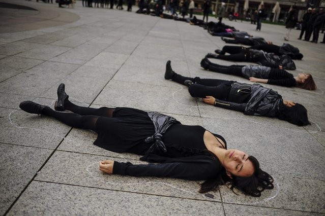A group of women lay on the street to protest violence against women, in Pamplona northern Spain, Friday, April 10, 2015. According to the World Health Organization recent global prevalence figures indicate that 35 percent of women worldwide have experienced either intimate partner violence or non-partner sexual violence in their lifetime. (Photo by Alvaro Barrientos/AP Photo)