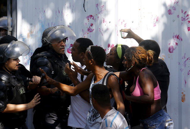 Squatters argue with riot policemen as they are evicted from an abandoned building in Flamengo neighborhood, in Rio de Janeiro, April 14, 2015. (Photo by Ricardo Moraes/Reuters)