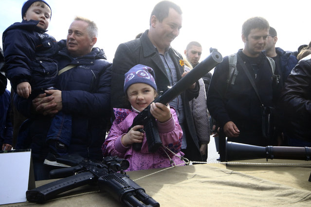 People inspect weapons during celebrations of thr Defender of the Fatherland Day in Sevastopol, Crimea, February 23, 2016. (Photo by Pavel Rebrov/Reuters)