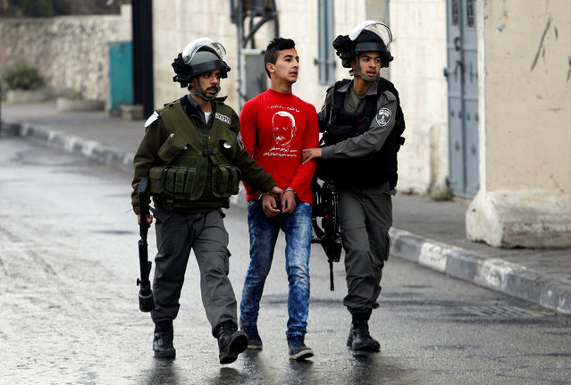 Israeli border policemen detain a Palestinian during clashes following a protest in the West Bank city of Bethlehem January 26, 2017. (Photo by Mussa Qawasma/Reuters)