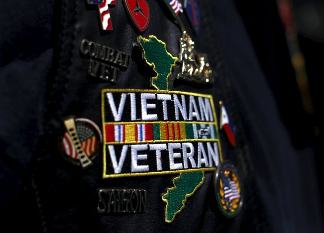 A Vietnam veteran wears patches and pins on his jacket as he attends the USS Midway's ceremony commemorating the 40th Anniversary of Operation Frequent Wind and the fall of Saigon in San Diego, California, United States April 26, 2015. (Photo by Mike Blake/Reuters)