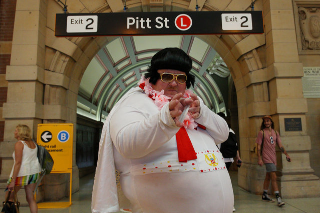 "A Elvis tribute artist poses at Central Station ahead of boarding the ""Elvis Express"" on January 10, 2019 in Sydney, Australia. The Parkes Elvis Festival is held annually over five days, timed to coincide with Elvis Presley's birth date in January. (Photo by Lisa Maree Williams/Getty Images)"