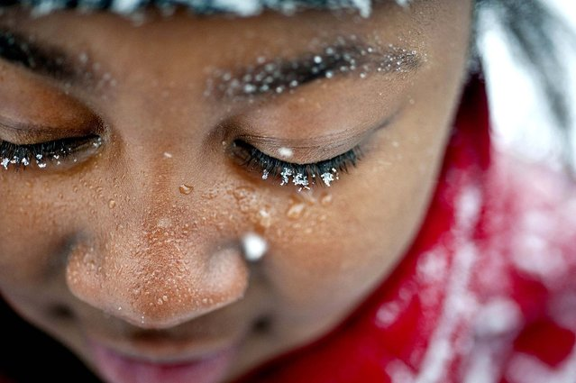 Snowflakes cling to nine-year-old Tamya Hardy's eyelashes as she plays in the snow with friends, in Winston-Salem, N.C., on January 28, 2014. (Photo by Lauren Carroll/Winston-Salem Journal)