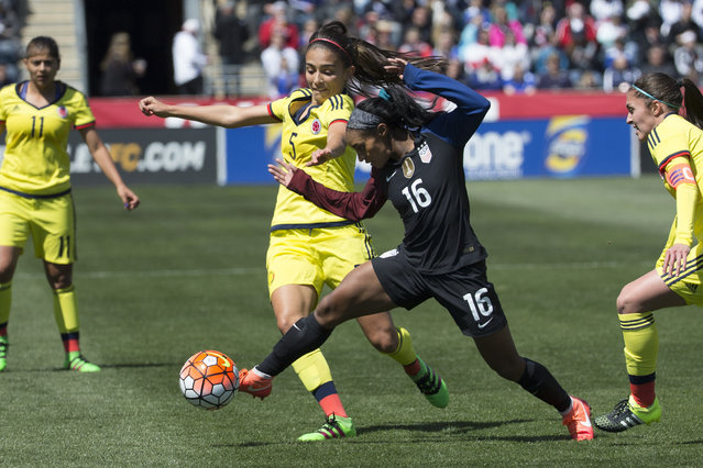 In this April 10, 2016, file photo, Colombia's Isabella Echeverri (5) battles for the ball against United States' Crystal Dunn (16) during the first half of an international friendly soccer match in Chester, Pa. Colombian women's national team players Isabella Echeverri and Melissa Ortiz are speaking out on social media about what they say are substandard conditions and discriminatory treatment by the federation. (Photo by Chris Szagola/AP Photo)