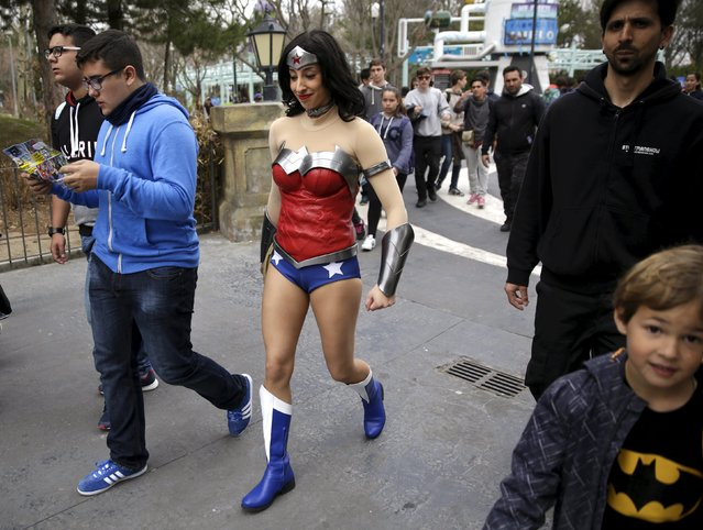 An actress dressed as Wonder Woman walks between visitors during the season inauguration of the Madrid Warner amusement park in San Martin de Valdeiglesias, near Madrid, Spain, March 18, 2016. (Photo by Andrea Comas/Reuters)