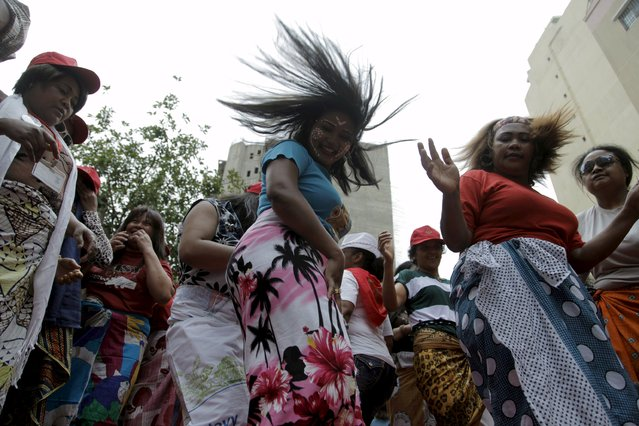 Migrant domestic workers dance during a parade in Beirut, to support the rights of migrant domestic workers in Lebanon and calling for a domestic workers union in Beirut May 3, 2015. (Photo by Alia Haju/Reuters)