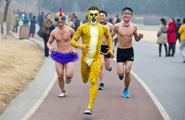 A man dressed as a leopard takes part in the annual 3.5 km undie run at Olympic Forst Park on February 23, 2014, in Beijing, China. More than 200 people who worn only underwear took part in a running race, which aimed at advocating healthy lifestyle and low-carbonlife.  (Photo by ChinaFotoPress/Getty Images)