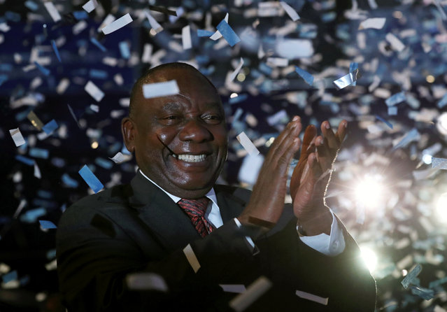 South African President Cyril Ramaphosa celebrates victory for his African National Congress (ANC) party at the announcement of results of the country's parliamentary and provincial elections in Pretoria, South Africa, May 11, 2019. (Photo by Mike Hutchings/Reuters)