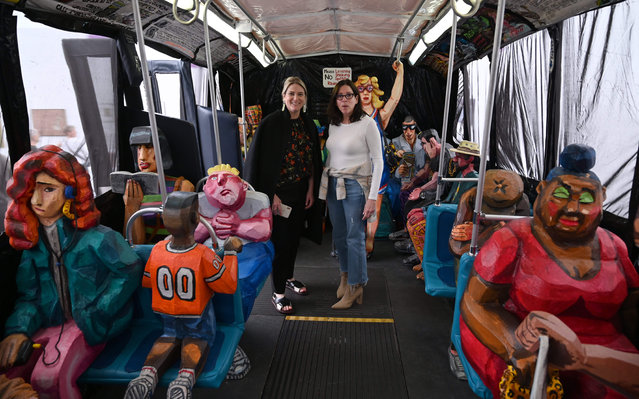"People look at the art of Red Grooms, ""The Bus"" (1995), during Frieze New York 2019 on May 2, 2019. The exhibit takes place in Randall's Island Park May 1-5, 2019. This year, the art fair introduces new collaborations with leading museums directors from institutions across the US. (Photo by Timothy A. Clary/AFP Photo)"