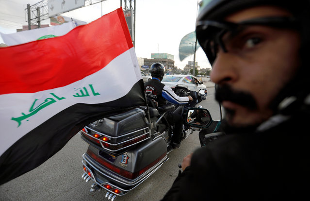 A member of Iraq Bikers, the first Iraqi biker group, drives with an Iraqi flag on his motorbike in Baghdad, Iraq on December 28, 2018. (Photo by Thaier Al-Sudani/Reuters)