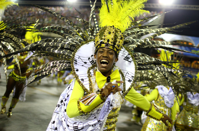 Revellers from Sao Clemente samba school perform during the second night of the carnival parade at the Sambadrome in Rio de Janeiro, Brazil February 28, 2017. (Photo by Pilar Olivares/Reuters)