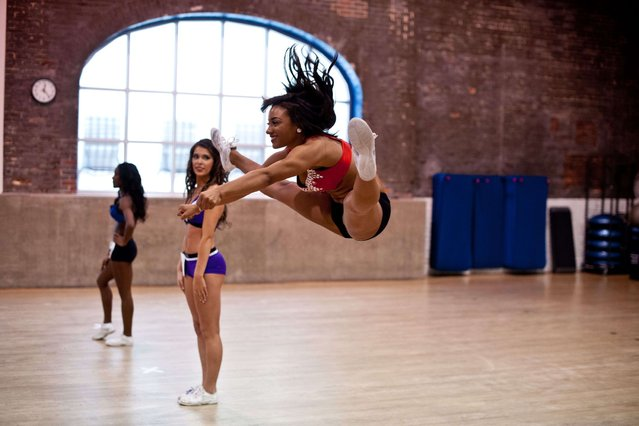 Aspiring cheerleaders attend the first day of the Baltimore Ravens tryouts at a gym in Batimore, Maryland, on March 8, 2014. The Ravens has the only co-ed cheer team in the NFL and is the only one to perform stunts. (Photo by Nicholas Kamm/AFP Photo)