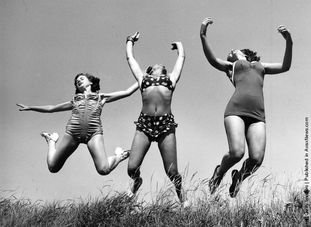 Three Windmill Theatre dancers enjoying the sun on the beach at Angmering during a break in rehearsals, 1952