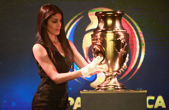 A model holds The Copa America Centenario trophy, to be awarded to the winning team of the 2016 Copa America, presented by the South American Football Confederation (CONMEBOL) in Bogota, Colombia, April 28, 2016. (Photo by John Vizcaino/Reuters)