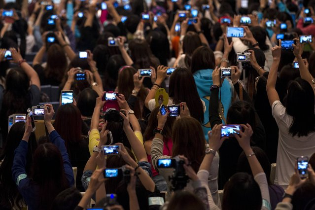 Fans take pictures of South Korean actor Kim Soo-hyun (not seen) during a fan meeting at a promotional event in Hong Kong April 23, 2014. (Photo by Tyrone Siu/Reuters)