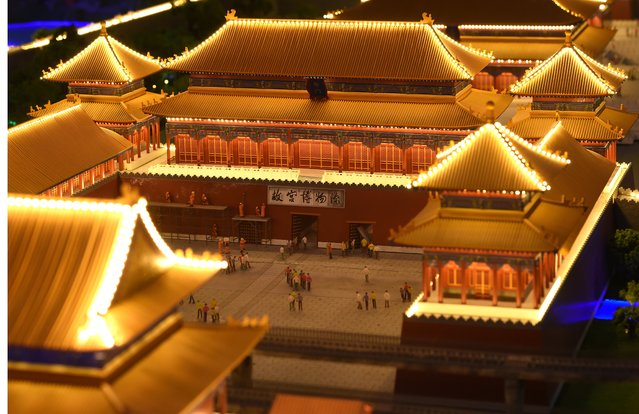A miniature model of the Forbidden City in Beijing, China, part of Gulliver's Gate, a miniature world being recreated in a 49,000-square-foot exhibit space in Times Square, is seen during a preview April 10, 2017 in New York City. (Photo by Timothy A. Clary/AFP Photo)