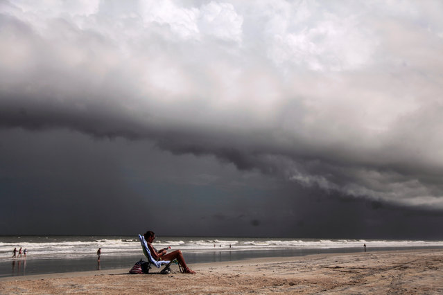 Tricia Cheshire, a resident of Amelia Island sunbathes for the last few minutes before storms hit the coast before Hurricane Dorian in Jacksonville, Florida, U.S. September 1, 2019. (Photo by Maria Alejandra Cardona/Reuters)
