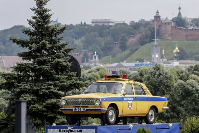 A Russian Volga GAZ-24 police car is displayed in the town of Nizhny Novgorod, Russia, July 10, 2015. (Photo by Maxim Shemetov/Reuters)