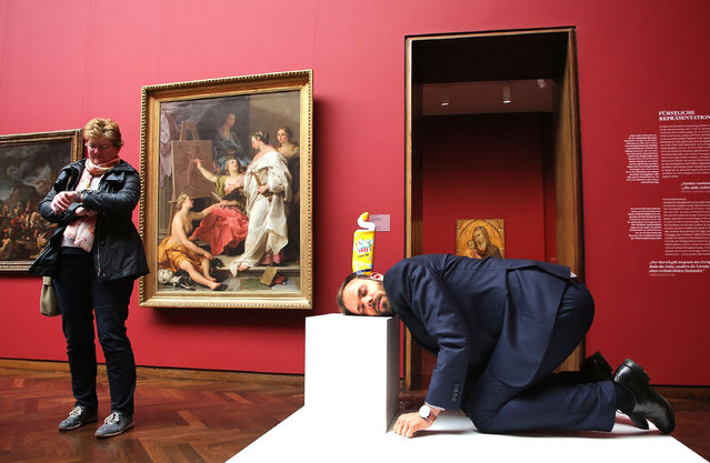 """A visitor performes during the Erwin Wurm """"One Minute Sculpture Exhibition"""", at the Staedel Museum on May 6, 2014 in Frankfurt am Main, Germany. (Photo by Hannelore Foerster/Getty Images)"""