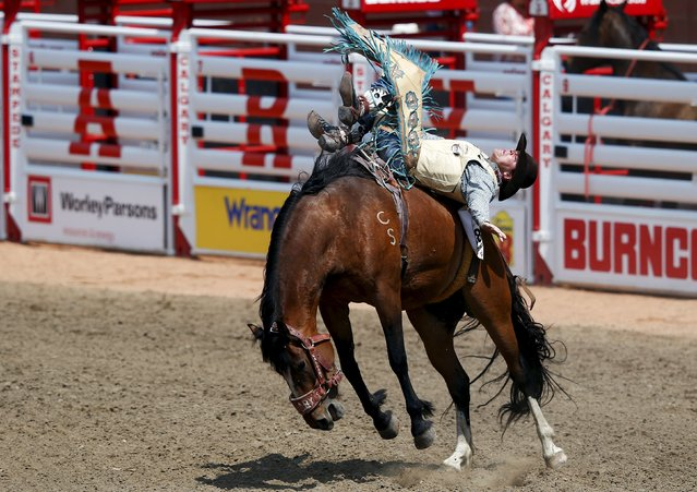 Jaden Clark of Wellfleet, Nebraska rides the horse Second Typhoon in the novice saddle bronc event during the Calgary Stampede rodeo in Calgary, Alberta, July 10, 2015. (Photo by Todd Korol/Reuters)