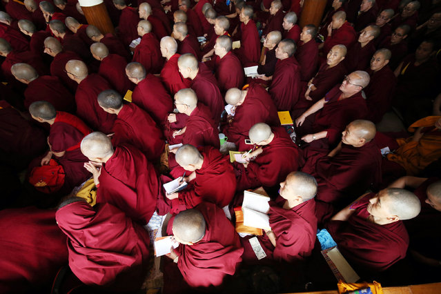 Tibetan monks and devotees attend second day the main Buddhist temple of Tsuglagkhang, near the town of Dharamsala, India, 04 October 2019. His Holiness holding three days of teachings on Nagarjuna's The Precious Garland of the Middle Way (uma rinchen trengwa) at the main Tibetan Temple. (Photo by Sanjay Baid/EPA/EFE)