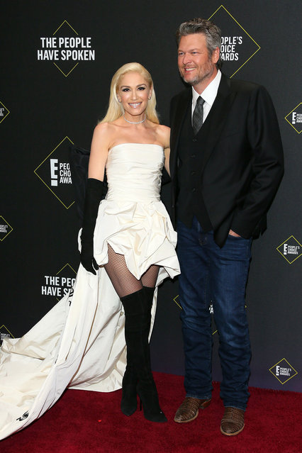 US singers/songwriters Gwen Stefani and Blake Shelton arrive for the 45th annual E! People's Choice Awards at Barker Hangar in Santa Monica, California, on November 10, 2019. (Photo by Jean-Baptiste Lacroix/AFP Photo)