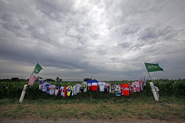 Cycling jerseys, part of a collection belonging to French cycling fan Gerald, hang from a line during the 4th stage of the Tour de France cycling race from Seraing in Belgium to Cambrai in France, July 7, 2015. (Photo by Eric Gaillard/Reuters)