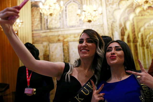 Participants take a selfie during the Miss Iraq Pageant in Baghdad,Iraq May 25, 2017. (Photo by Thaier Al-Sudani/Reuters)