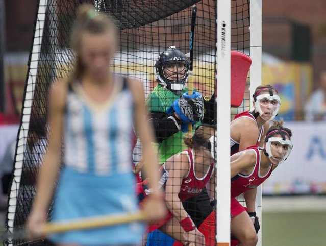 Players of the United States wait for a short corner by Argentina's Agustina Habif during the women's field hockey gold medal final at the Pan Am Games in Toronto, Friday, July 24, 2015. (Photo by Darren Calabrese/The Canadian Press via AP Photo)