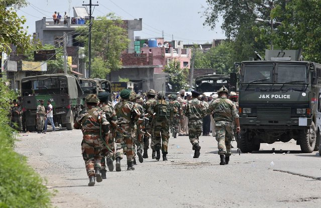 Indian army soldiers patrol near the site of a gunfight at Dinanagar town in Gurdaspur district of Punjab, India, July 27, 2015. India tightened security on the border with old enemy Pakistan on Monday after heavily armed men stormed a police station in the northern frontier state of Punjab, killing six people and wounding several others. (Photo by Munish Sharma/Reuters)
