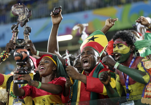 Ghana fans react before the group G World Cup soccer match between Ghana and the United States at the Arena das Dunas in Natal, Brazil, Monday, June 16, 2014. (Photo by Dolores Ochoa/AP Photo)