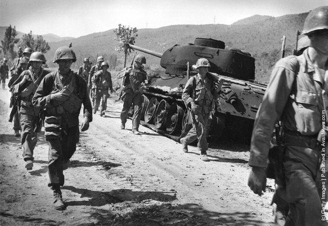 American troops walking down a road in Korea