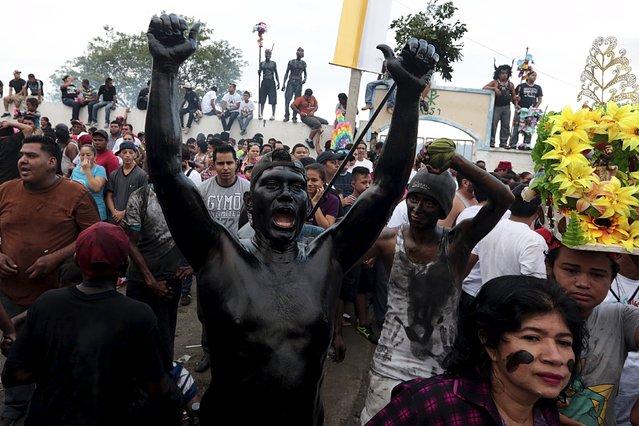 A devotee covered in motor oil takes part in celebrations honouring the patron saint of Managua, Santo Domingo de Guzman, in Managua, Nicaragua, August 1, 2015. (Photo by Oswaldo Rivas/Reuters)