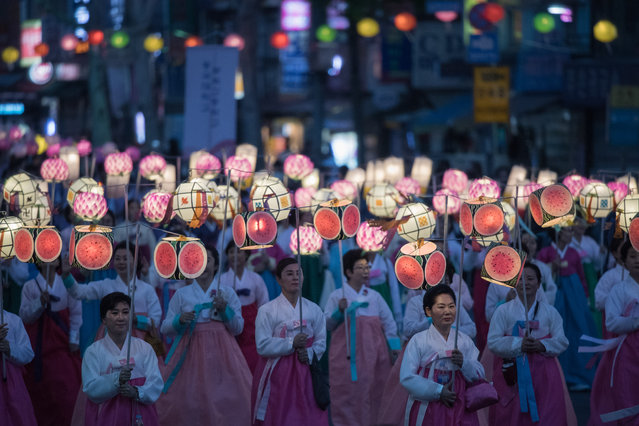 "Participants march during a lantern parade marking the start of a month-long ""Lotus Lantern Festival"" to celebrate the upcoming Buddha's birthday, in Seoul on April 29, 2017. Buddha's birthday falls on May 3. (Photo by Ed Jones/AFP Photo)"