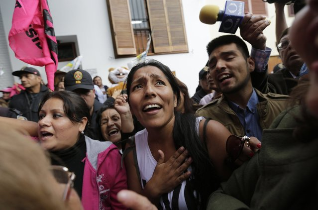Supporters of presidential candidate Pedro Pablo Kuczynski celebrate after learning that Peruvian electoral authorities announced their candidate won the majority of votes in the country's closest presidential contest in five decades, in Lima, Peru, Thursday, June 9, 2016. Four days after voting, the electoral board said that all ballots had been processed and Kuczynski had won 51.1 percent compared to 49.9 percent for the daughter of imprisoned ex-President Alberto Fujimori. (Photo by Silvia Izquierdo/AP Photo)