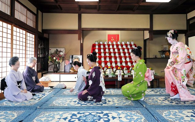 "Geiko and maiko visit Inoue Yachiyo (1st L), master of Japanese traditional dance school, during an annual gratitude event for the past year and best wishes for New Year on December 13, 2019 in Kyoto, Japan. The annual ritual is called ""Kotohajime"", and is the start of preparation for the new year. (Photo by The Asahi Shimbun via Getty Images)"