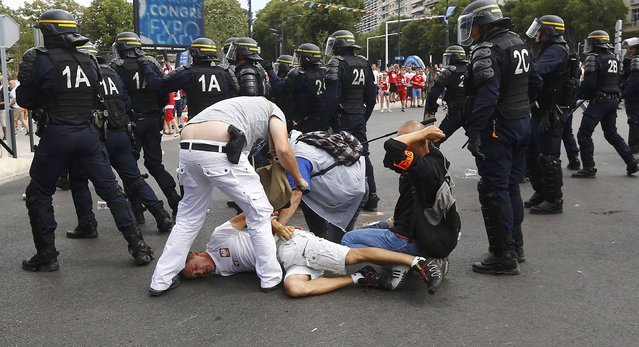 Football Soccer, EURO 2016, Marseille, France on June 21, 2016. Poland fans are detained by police in Marseille, France.     REUTERS/Wolfgang Rattay