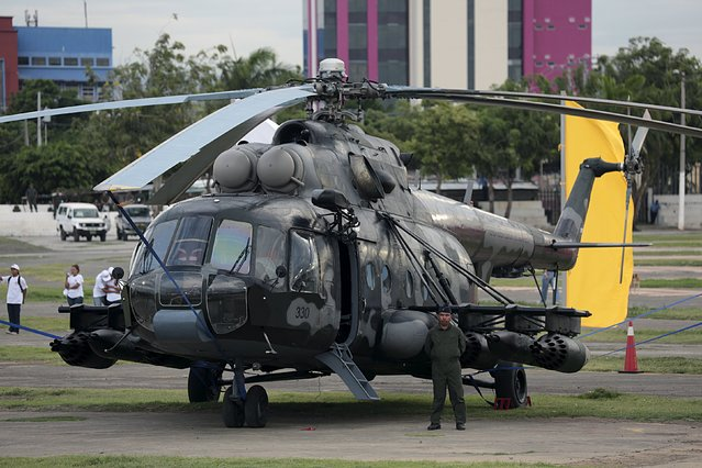 A member of the Nicaraguan Air Force stands next to a Russian-made helicopter during celebrations marking the 36th anniversary of the establishment of the Nicaraguan Air Force, at the Juan Pablo II square in Managua, Nicaragua August 12, 2015. (Photo by Oswaldo Rivas/Reuters)