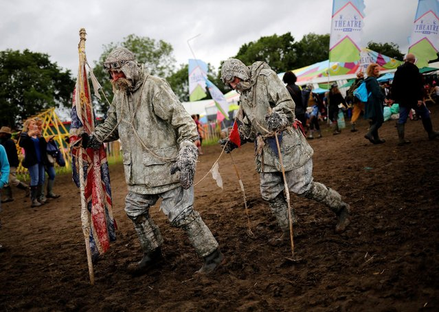 Actors entertain the revellers at Worthy Farm in Somerset during the Glastonbury Festival, Britain, June 26, 2016. (Photo by Stoyan Nenov/Reuters)