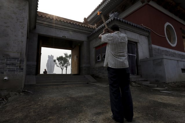 A man prays at Chaoyin Temple, Tianjin, China, August 14, 2015. (Photo by Jason Lee/Reuters)