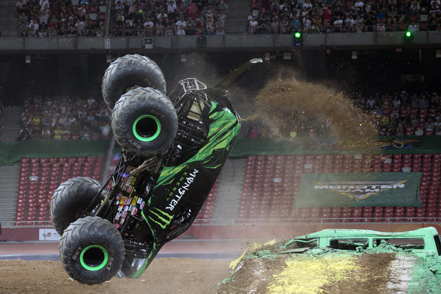 "A Monster Jam truck performs a back flip during the first-ever monster truck event in Beijing's iconic ""Bird's Nest"" National Stadium on Saturday, July 29, 2017. (Photo by Ng Han Guan/AP Photo)"