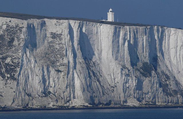 South Foreland lighthouse and the white cliffs of Dover are seen from a cross-channel ferry between Dover in Britain and Calais in France, March 27, 2017. (Photo by Toby Melville/Reuters)