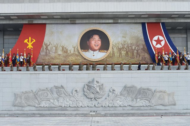 Military personnel salute a portrait of North Korean leader Kim Jong Un during an event at the plaza of the Kumsusan Palace of the Sun marking the 61st anniversary of the armistice that ended the Korean War taken on July 27, 2014 in this photo released by North Korea's Korean Central News Agency (KCNA) in Pyongyang July 28, 2014. (Photo by Reuters/KCNA)
