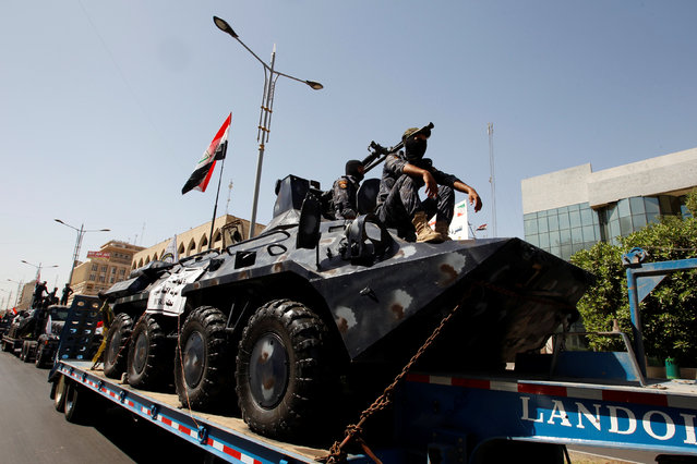 Iraqi security forces vehicles take part in a military parade in the streets of Baghdad, Iraq July 12, 2016. (Photo by Khalid al Mousily/Reuters)
