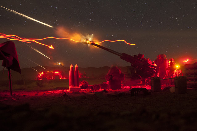 U.S. Marines with Lima Battery, 3rd Battalion, 11th Marine Regiment, fire M777A2 Lightweight Howitzers during exercise Steel Knight on Marine Corps Air Ground Combat Center Twentynine Palms, Calif., December 11, 2012. (Photo by Lance Cpl. Jason Morrison/U.S. Marine Corps photo)