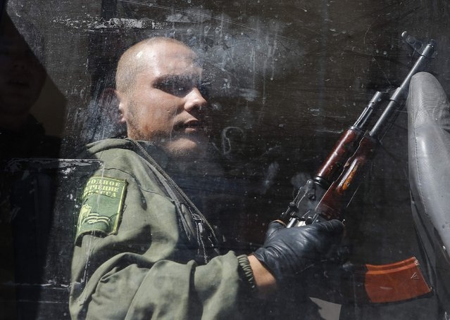 An armed pro-Russian separatist sits in a bus after a rally in Donetsk August 24, 2014. (Photo by Maxim Shemetov/Reuters)