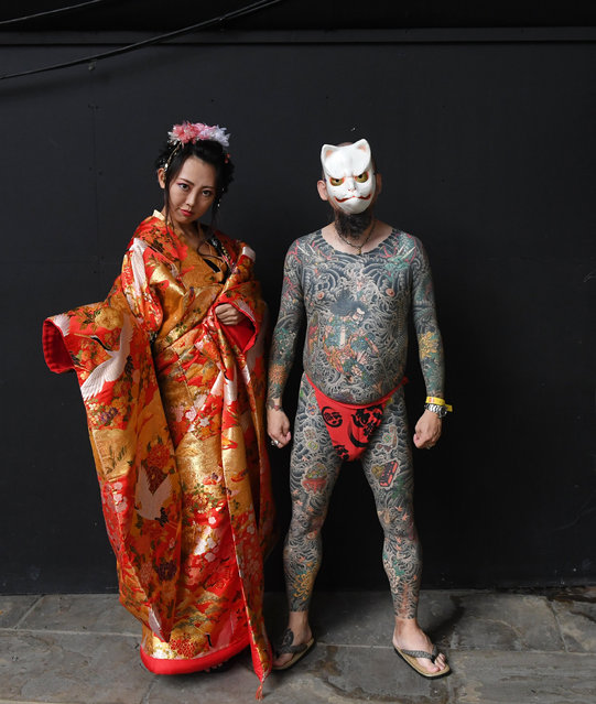 Tattooed visitors pose for photographs during the London Tattoo Convention at the Tobacco Docks, in London, Britain, 24 September 2017. (Photo by Facundo Arrizabalaga/EPA/EFE)